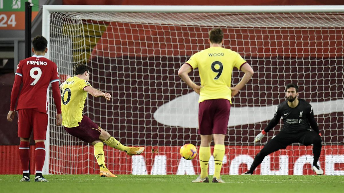 Ashley Barnes of Burnley scores their side's first goal past Alisson Becker of Liverpool from the penalty spot during the Premier League match between Liverpool and Burnley at Anfield on January 21, 2021 in Liverpool, England.