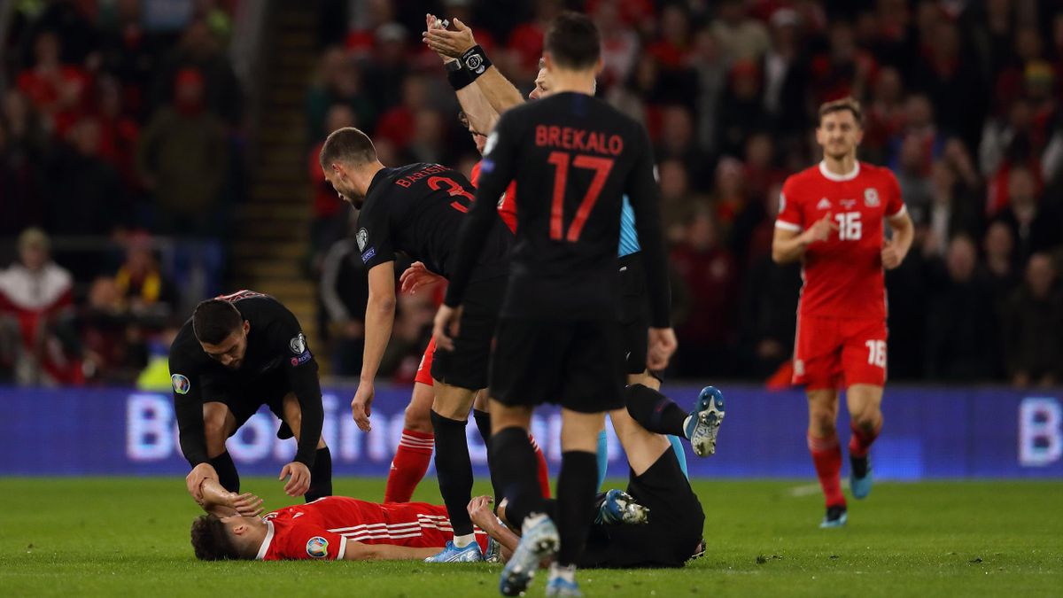 CARDIFF, WALES - OCTOBER 13: Daniel James of Wales lies on the ground knocked out during the UEFA Euro 2020 qualifier between Wales and Croatia at Cardiff City Stadium on October 13, 2019 in Cardiff, Wales. (Photo by Matthew Ashton - AMA/Getty Images)