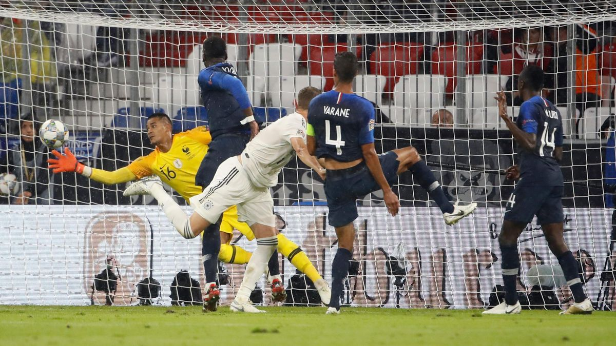 France's goalkeeper Alphonse Areola (L) makes a save during the UEFA Nations League football match Germany against France on September 6, 2018 in Munich, southern Germany.