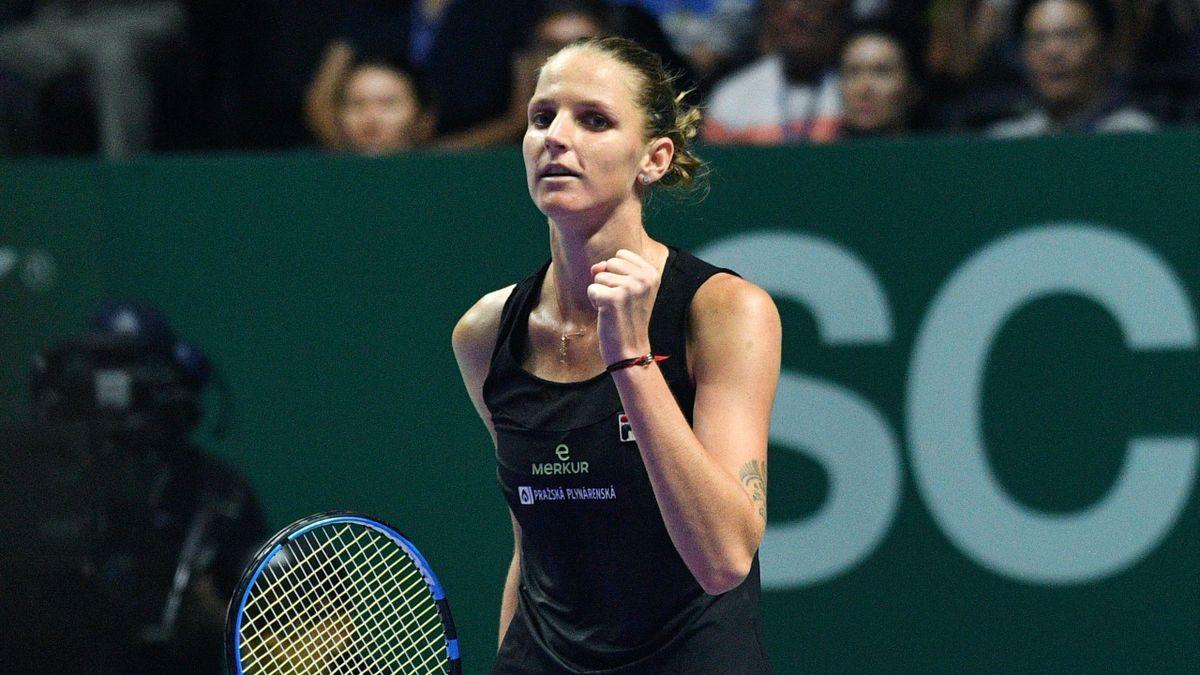 Czech Republic's Karolina Pliskova celebrates after defeating Denmark's Caroline Wozniacki during their women's singles match at the WTA Finals tennis tournament in Singapore on October 21, 2018