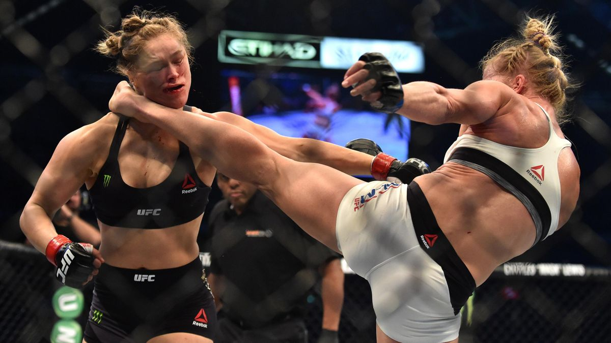 Holly Holm of the US (R) lands a kick to the neck to knock out compatriot Ronda Rousey