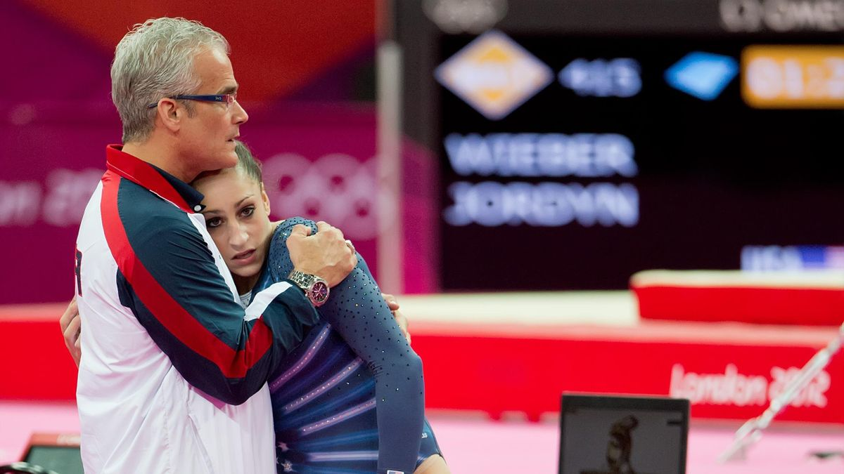 Jordyn Wieber of the United States received a hug from her coach, John Geddert, left, in the women's floor exercises apparatus finals at North Greenwich Arena during the 2012 Summer Olympic Games in London, England, Tuesday, August 7, 2012