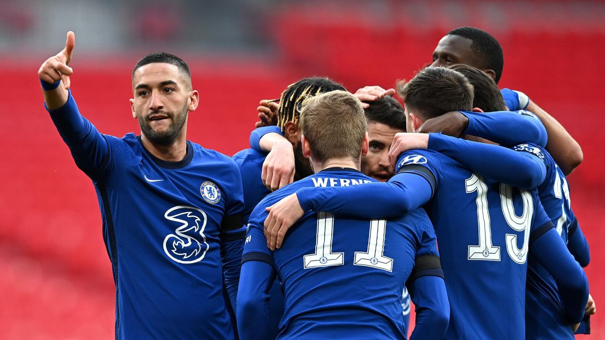 Hakim Ziyech of Chelsea celebrates with teammates after scoring their team's first goal during the Semi Final of the Emirates FA Cup match between Manchester City and Chelsea FC at Wembley Stadium on April 17, 2021 in London, England