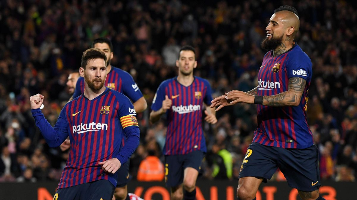 Lionel Messi of Barcelona celebrates after scoring his team's second goal with Arturo Vidal of Barcelona during the La Liga match between FC Barcelona and Rayo Vallecano de Madrid at Camp Nou on March 09, 2019 in Barcelona, Spain.