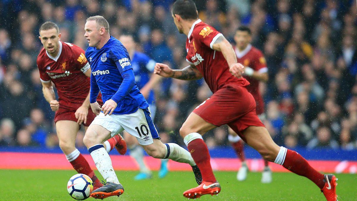 2018. Wayne Rooney of Everton is tracked by Jordan Henderson and Dejan Lovren of Liverpool