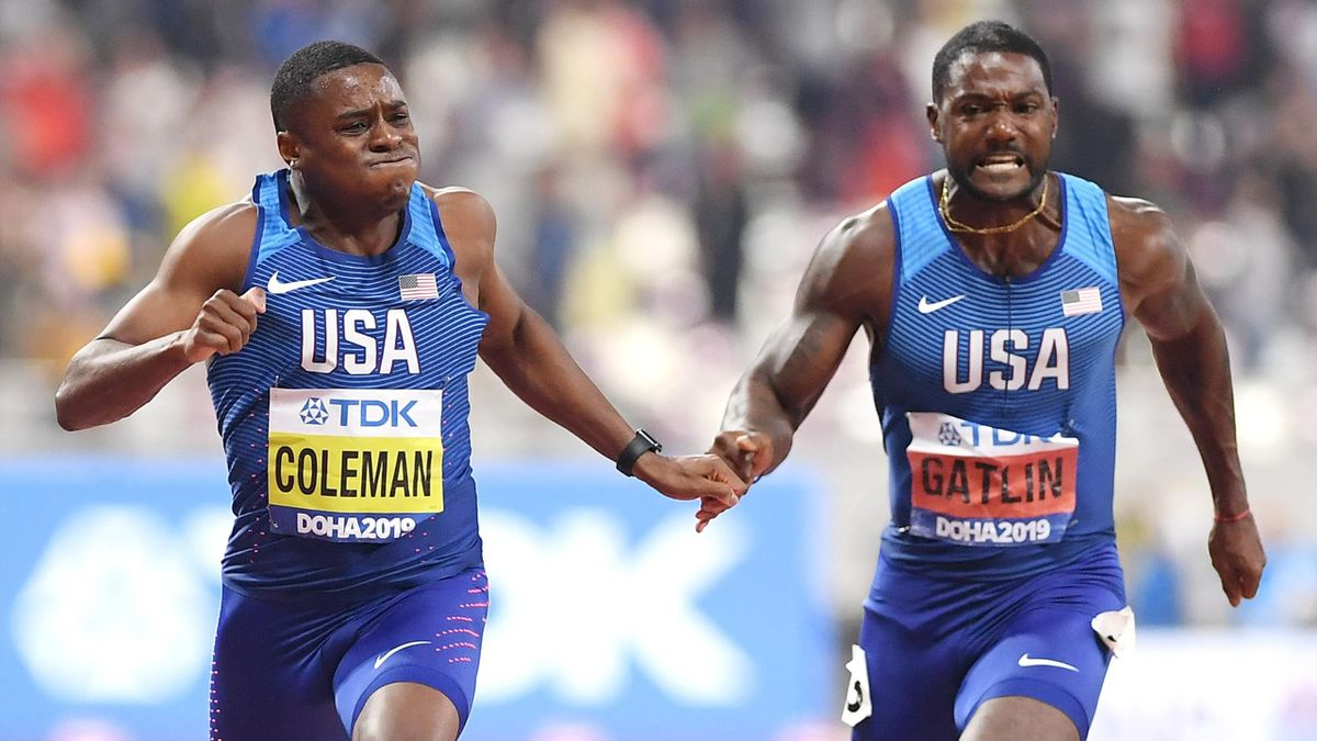 DOHA, QATAR - SEPTEMBER 28: Christian Coleman of the United States crosses the finish line next to Justin Gatlin of the United States to win the Men's 100 Metres final final during day two of 17th IAAF World Athletics Championships Doha 2019 at Khalifa In