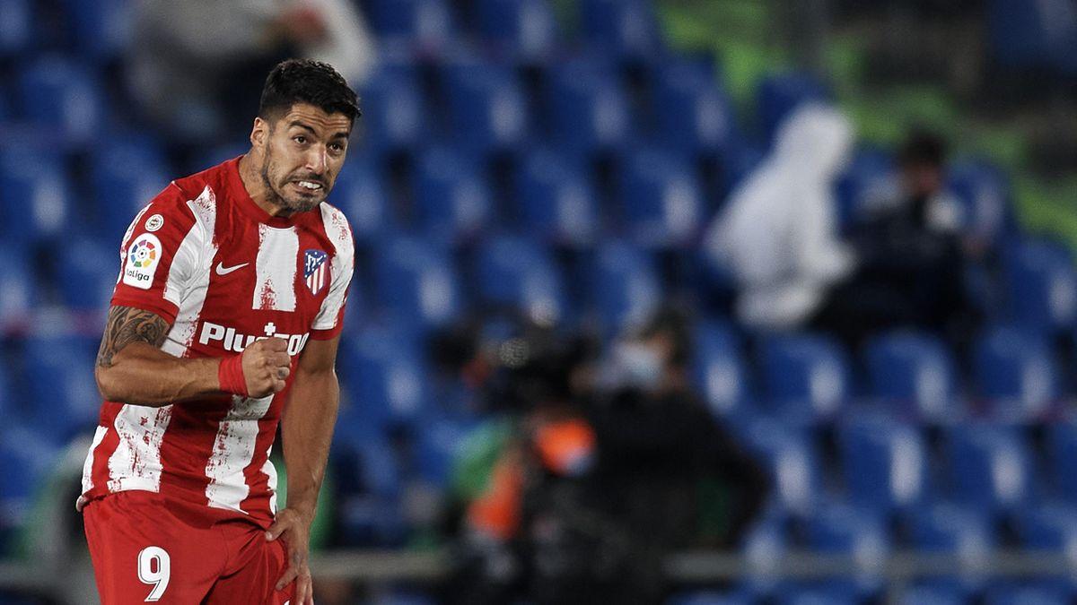 Suarez strikes at the death to send Atleti top