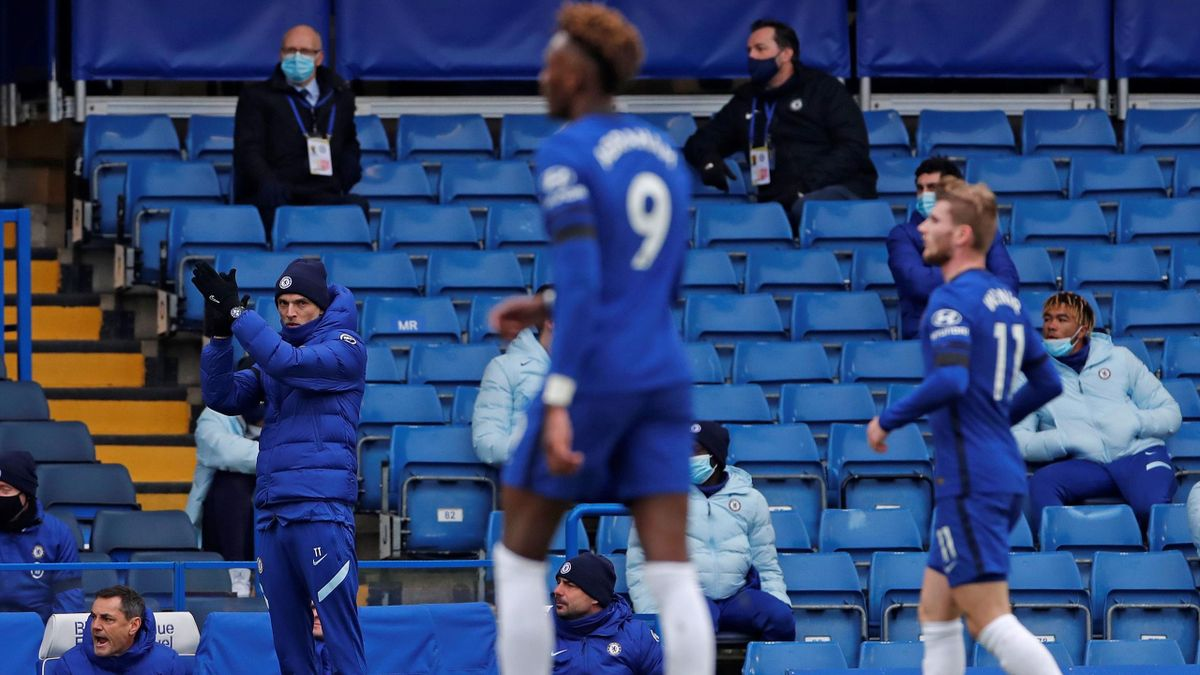 Chelsea's German head coach Thomas Tuchel applauds his players during the English Premier League football match between Chelsea and Burnley at Stamford Bridge in London
