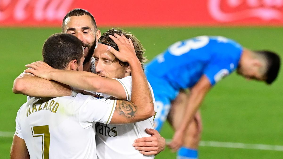 Real Madrid's French forward Karim Benzema (C) celebrates his goal with teammates goal during the Spanish league football match between Real Madrid CF and Valencia CF at the Alfredo di Stefano stadium in Valdebebas, on the outskirts of Madrid, on June 18