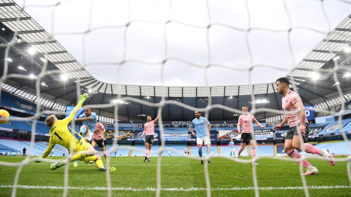Gabriel Jesus of Manchester City scores their side's first goal during the Premier League match between Manchester City and Sheffield United at Etihad Stadium on January 30, 2021 in Manchester