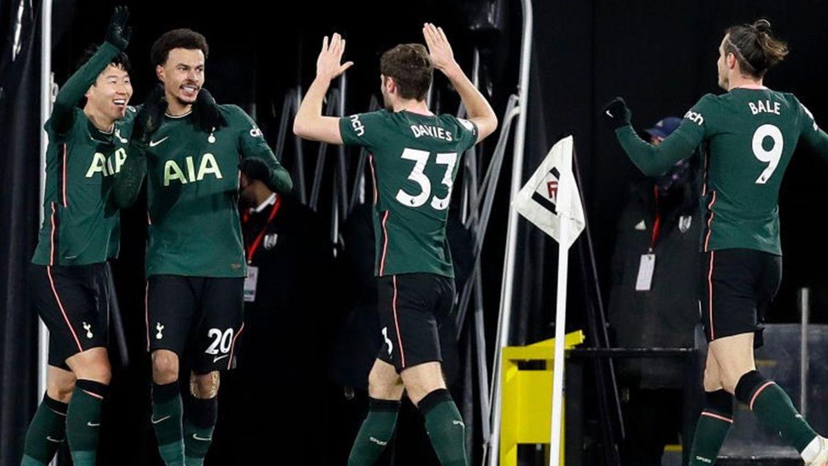 Dele Alli of Tottenham Hotspur celebrates with teammates Son Heung-Min, Ben Davies, and Gareth Bale