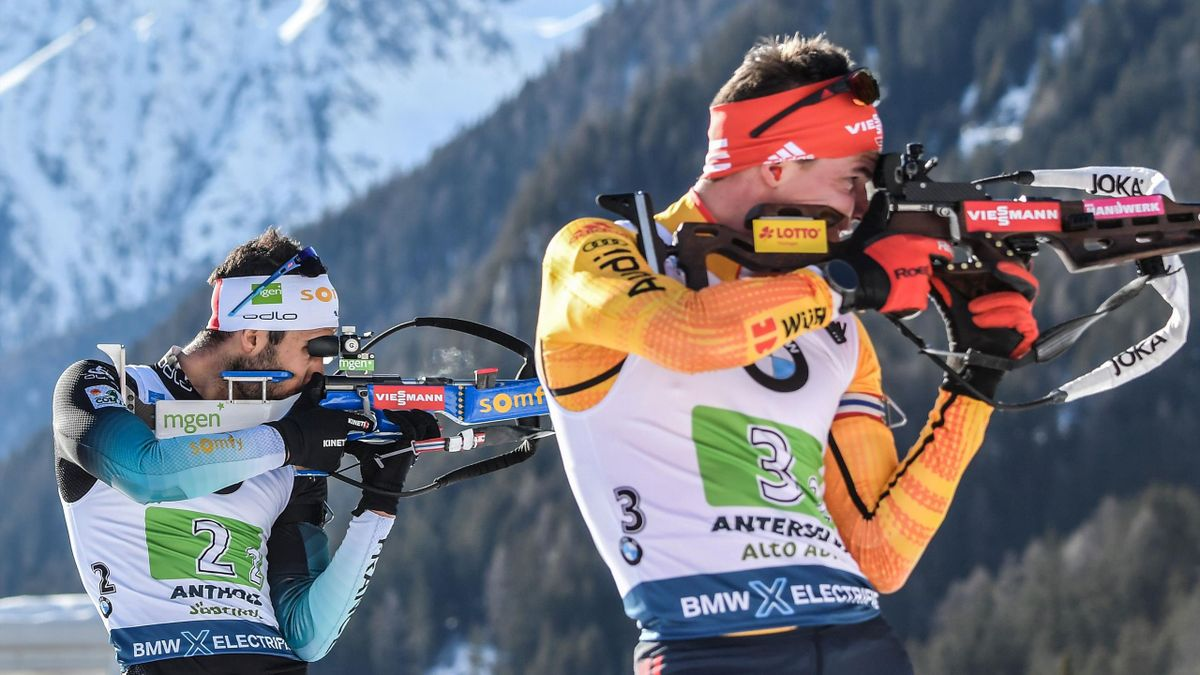 French Martin Fourcade (L) and German Philipp Horn compete in the Men 4x7.5 km Relay Competition at the IBU Biathlon World Cup in Rasen-Antholz (Rasun Anterselva), Italian Alps, on February 22, 2020