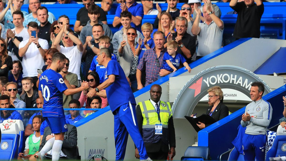 Maurizio Sarri manager of Chelsea congratulates Eden Hazard on his hat-trick as fans and coaching staff give a standing ovation during the Premier League match between Chelsea FC and Cardiff City at Stamford Bridge