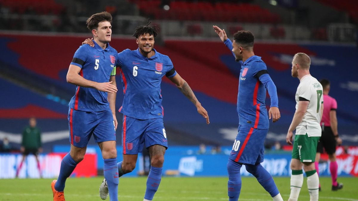 Harry Maguire of England celebrates with Tyrone Mings and Jadon Sancho