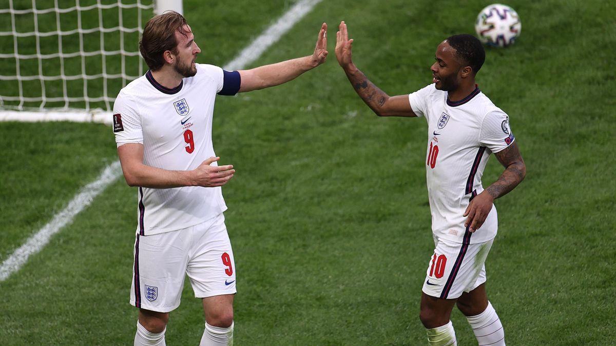 Harry Kane celebrates with Raheem Sterling