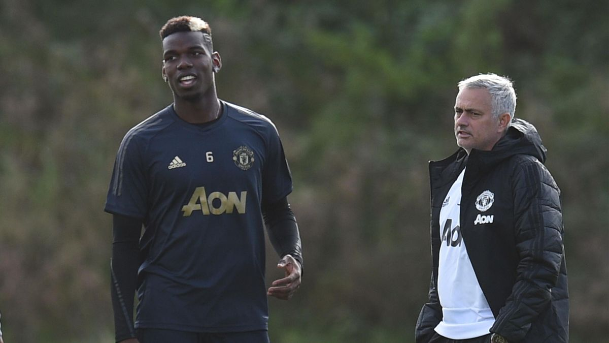 Manchester United's Portuguese manager Jose Mourinho (R) and Manchester United's French midfielder Paul Pogba (L) attend a training session at the Carrington Training complex in Manchester