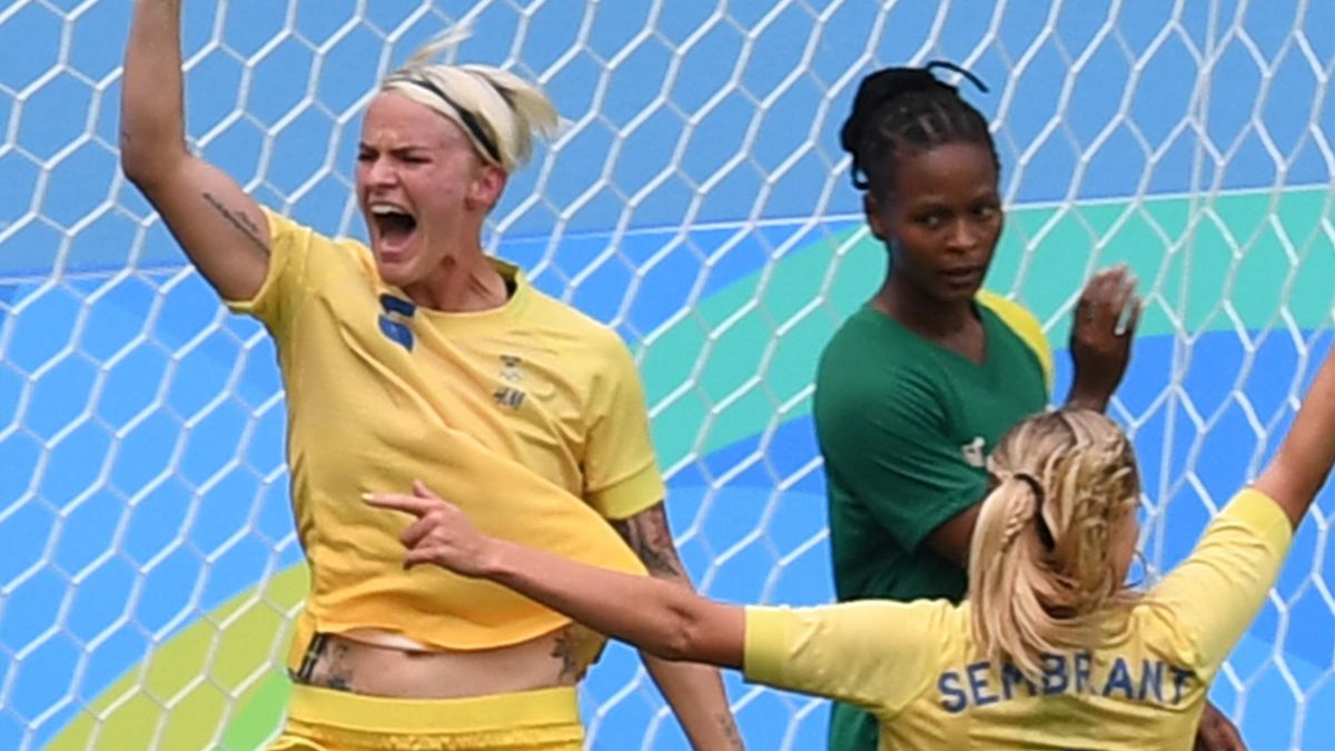 Sweden player Nilla Fischer (L) celebrates her goal against South Africa during the Rio 2016 Olympic Games women's First Round Group E football match Sweden vs South Africa, at the Olympic Stadium in Rio de Janeiro on August 3, 2016