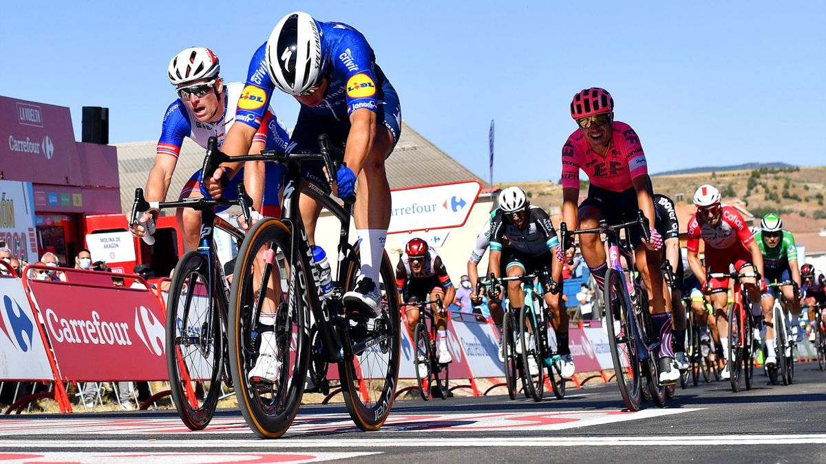 MOLINA DE ARAGON, SPAIN - AUGUST 17: Fabio Jakobsen of Netherlands and Team Deceuninck - Quick-Step sprints to win ahead of Arnaud Demare of France and Team Groupama - FDJ and Magnus Cort Nielsen of Denmark and Team EF Education - Nippo during the 76th To