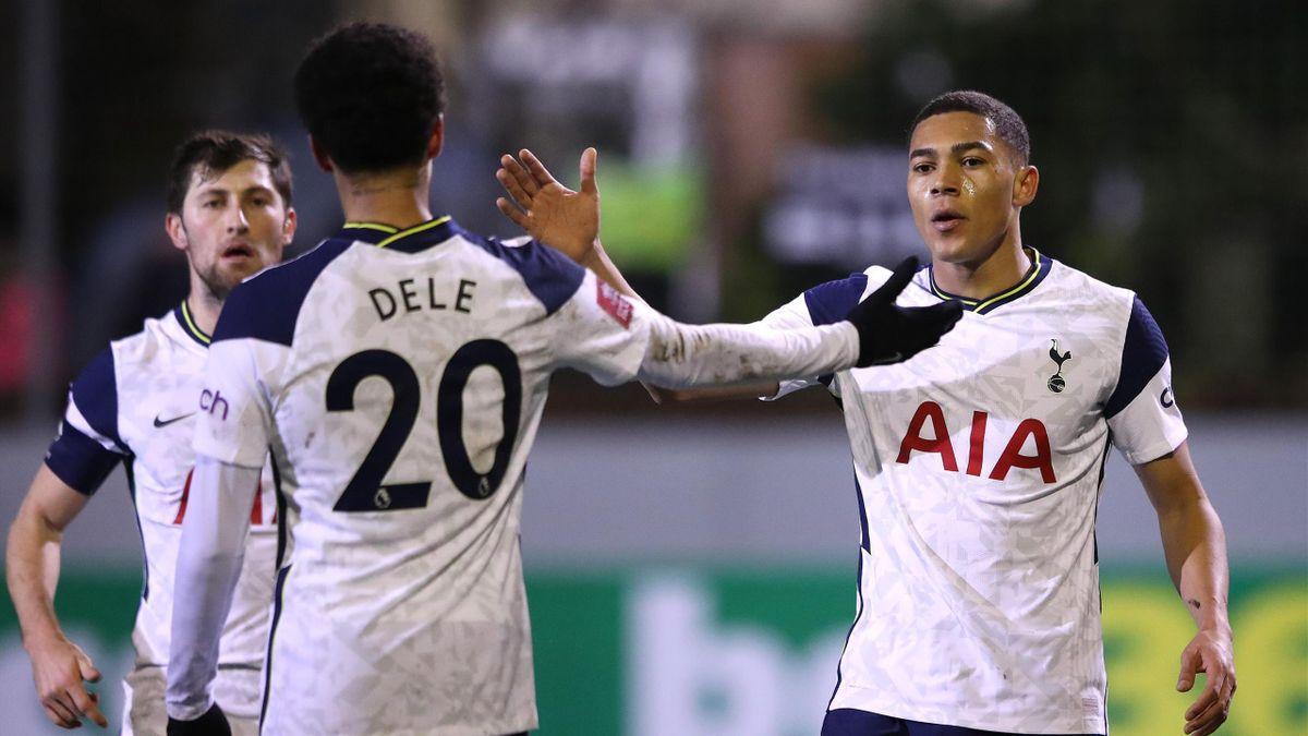 Dele Alli celebrates with goalscorer Carlos Vinicius during Marine v Tottenham