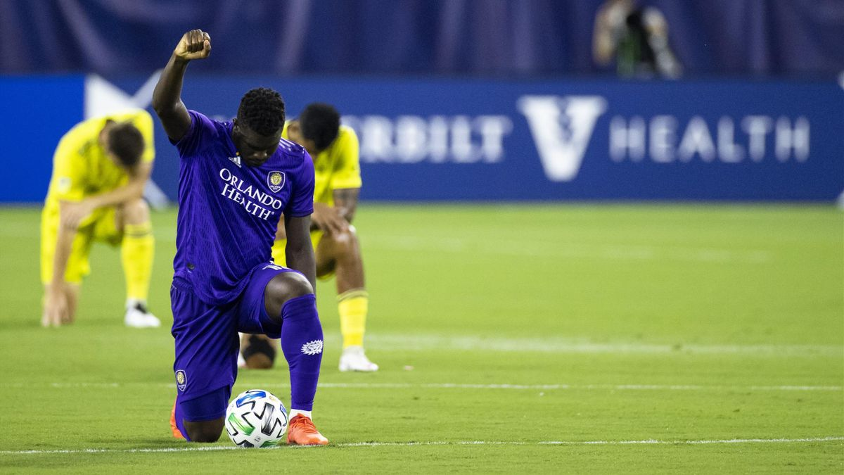 Daryl Dike takes a knee before an Orlando City and Nashville SC match