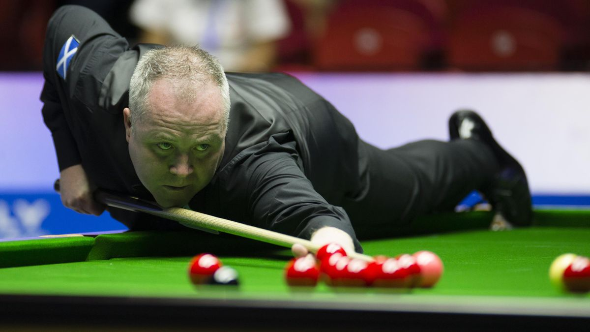 John Higgins of Soctland plays a shot in the semi-final match against Yan Bingtao and Ding Junhui of China on day seven of 2019 Beverly World Cup at Wuxi City Sports Stadium on June 30, 2019 in Wuxi, Jiangsu Province of China.