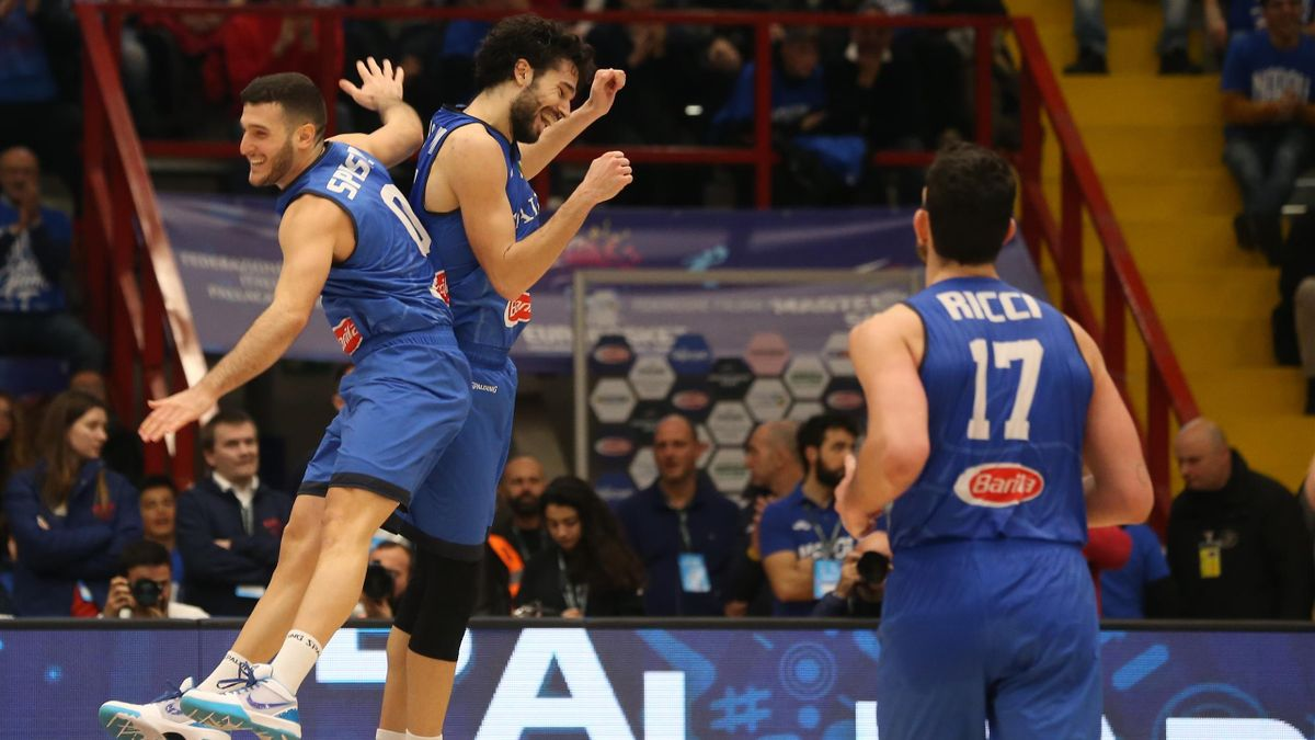 Italy's point guard Marco Spissu (L) celebrates with Italy's point guard Michele Vitali during the FIBA Eurobasket 2021 Group B qualifiers basket match Italy vs Russia.