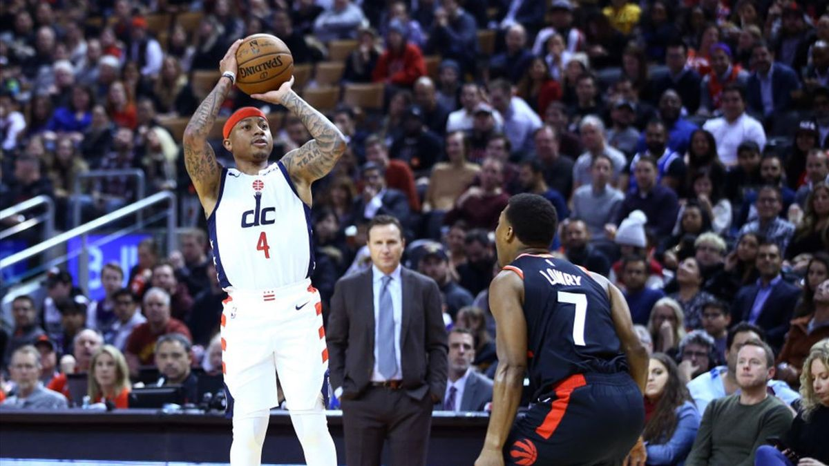 Isaiah Thomas #4 of the Washington Wizards shoots the ball as Kyle Lowry #7 of the Toronto Raptors defends during the first half of an NBA game at Scotiabank Arena on December 20, 2019 in Toronto, Canada