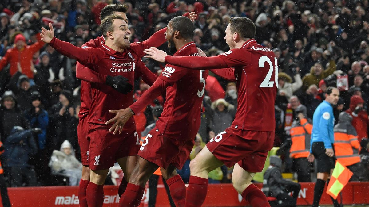 Liverpool's Swiss midfielder Xherdan Shaqiri (L) celebrates with teammates after scoring their second goal during the English Premier League football match between Liverpool and Manchester United at Anfield in Liverpool, north west England on December 16,