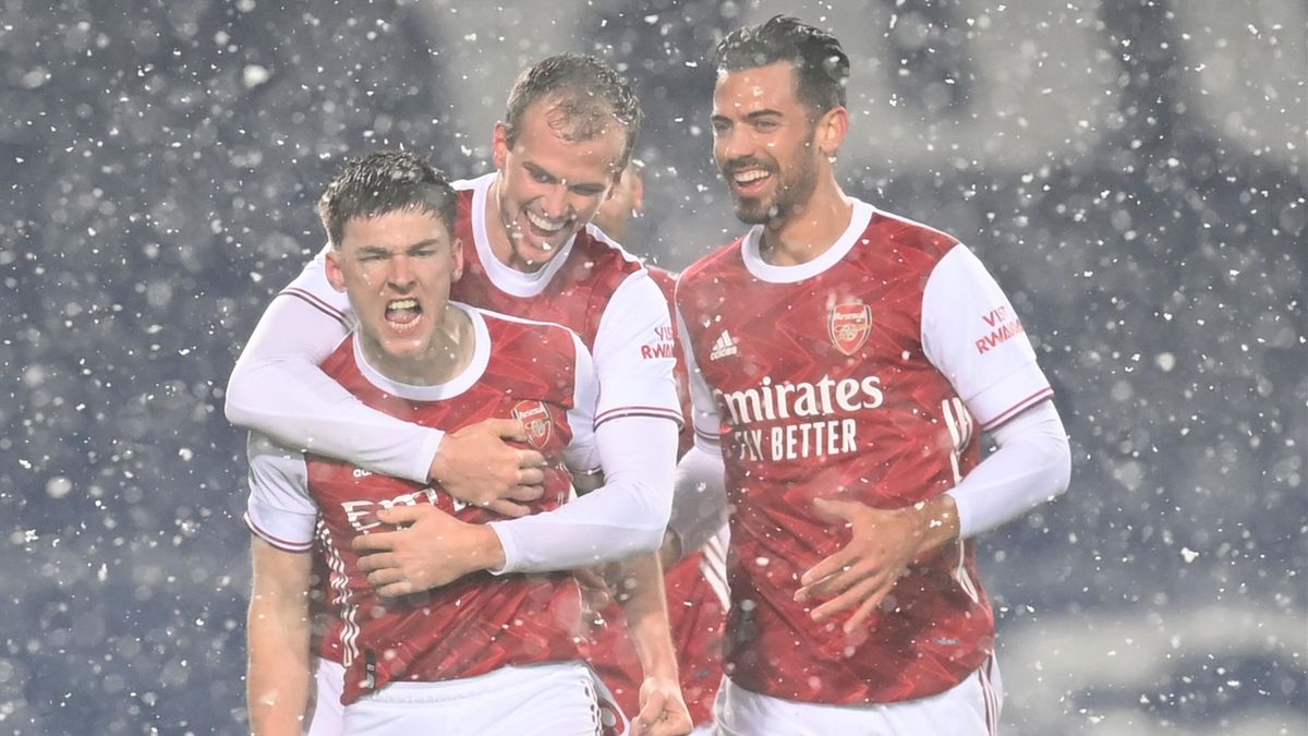 Arsenal's Scottish defender Kieran Tierney (L) celebrates after scoring the opening goal during the English Premier League football match between West Bromwich Albion and Arsenal at The Hawthorns stadium