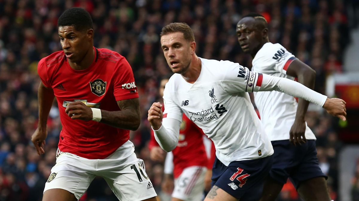 Marcus Rashford of Manchester United in action with Jordan Henderson of Liverpool during the Premier League match between Manchester United and Liverpool FC at Old Trafford on October 20, 2019