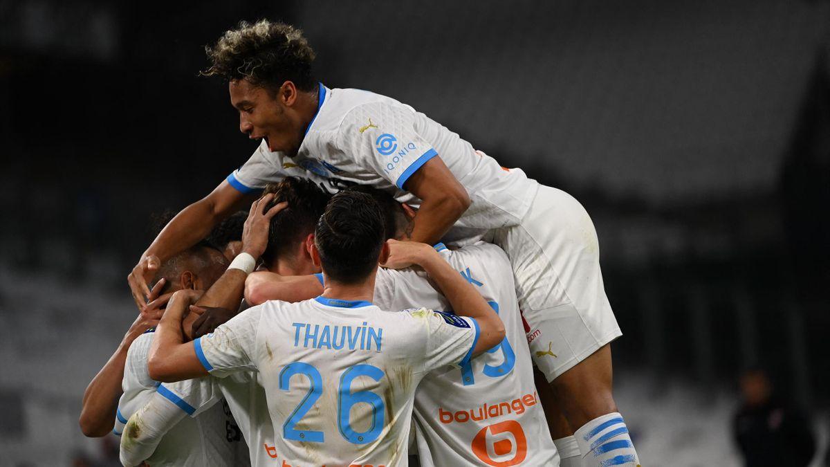 Marseille's Argentine defender Leonardo Balerdi celebrates with teammates after scoring during the French L1 football match between Olympique de Marseille