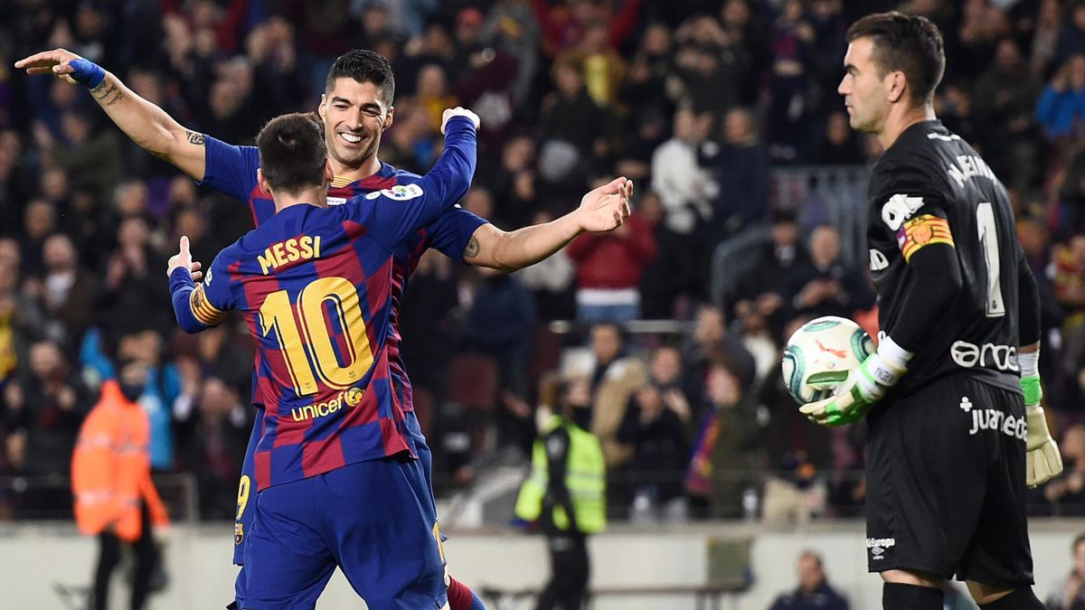 Leo Messi, Luis Suárez (Barcelona) y Manolo Reina (Mallorca)