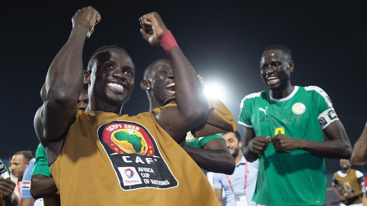 Sadio Mané (left) and Cheikhou Kouyate of Senegal celebrate victory after winning the 2019 Africa Cup of Nations Semi Final match between Senegal and Tunisia at 30th June Stadium on July 14, 2019 in Cairo, Egypt.