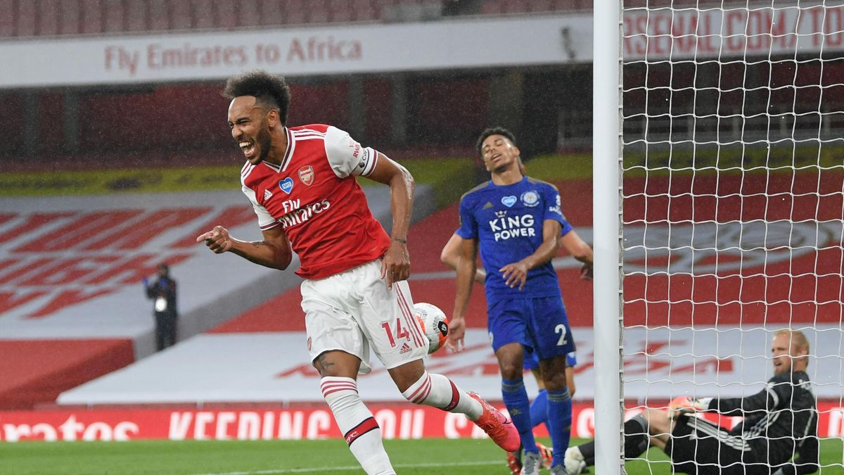 Pierre-Emerick Aubameyang of Arsenal celebrates after scoring his team's first goal during the Premier League match between Arsenal FC and Leicester City at Emirates Stadium on July 07, 2020 in London, England. Football Stadiums around Europe remain empt