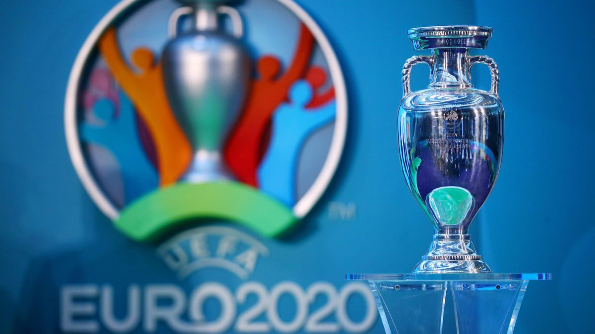 The UEFA European Championship trophy is displayed next to the logo for the UEFA EURO 2020 tournament during the UEFA EURO 2020 launch event for London at City Hall on September 21, 2016 in London, England