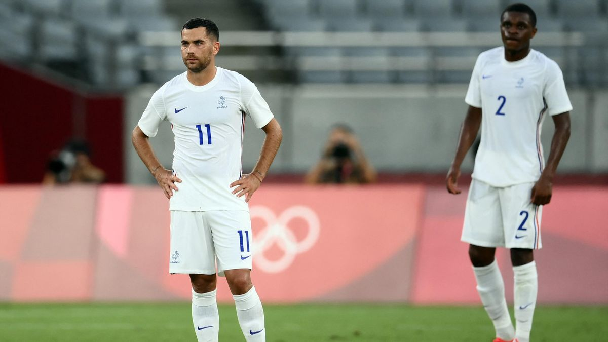 France's midfielder Teji Savanier (L) and France's defender Pierre Kalulu react to Mexico's third goal during the Tokyo 2020 Olympic Games men's group A first round football match between Mexico and France at Tokyo Stadium in Tokyo on July 22, 2021