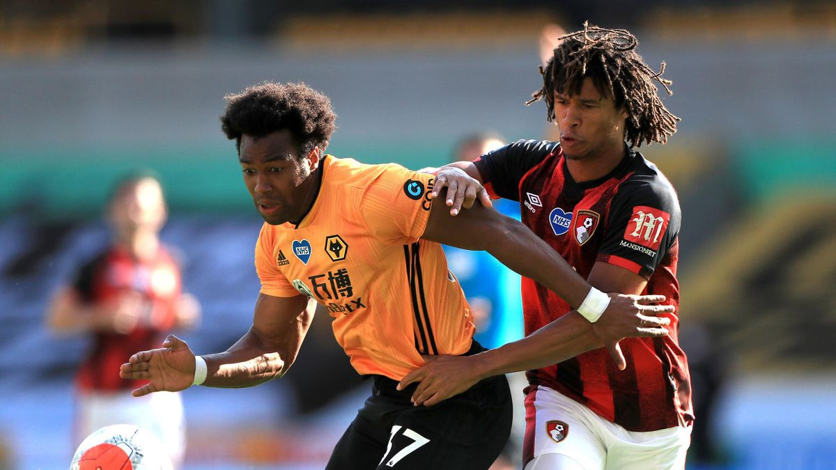 Adama Traore of Wolverhampton Wanderers battles for possession with Nathan Ake of AFC Bournemouth during the Premier League match between Wolverhampton Wanderers and AFC Bournemouth at Molineux