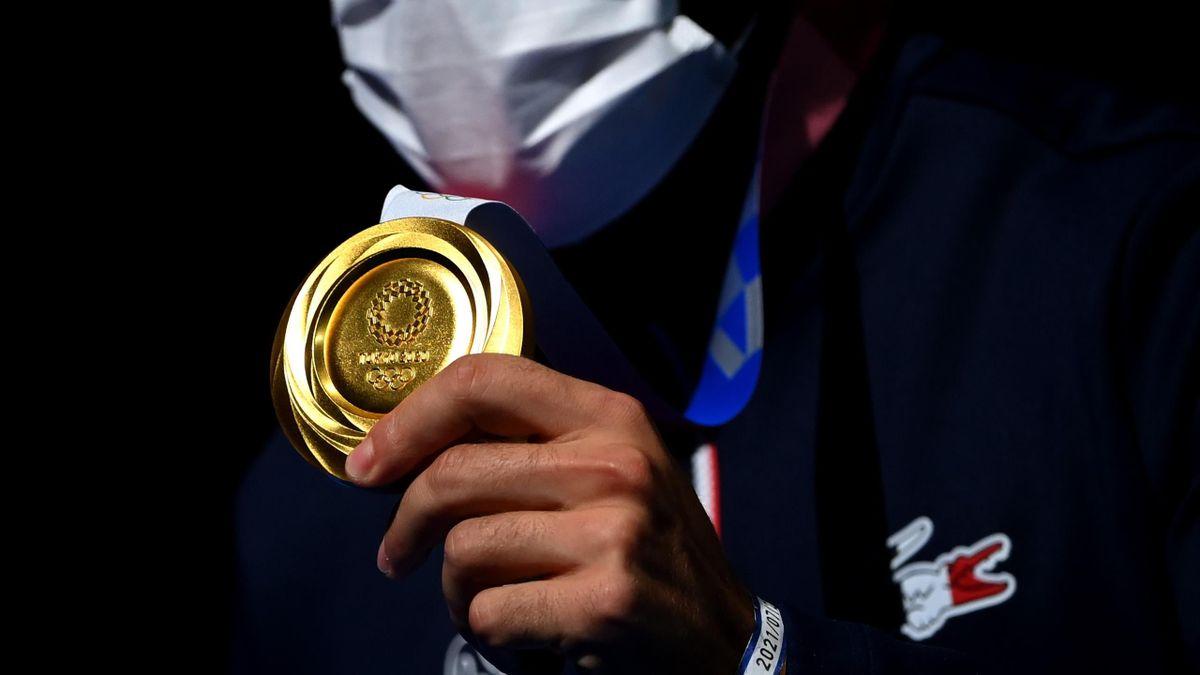 Romain Cannone avec sa médaille d'or à Tokyo 2020