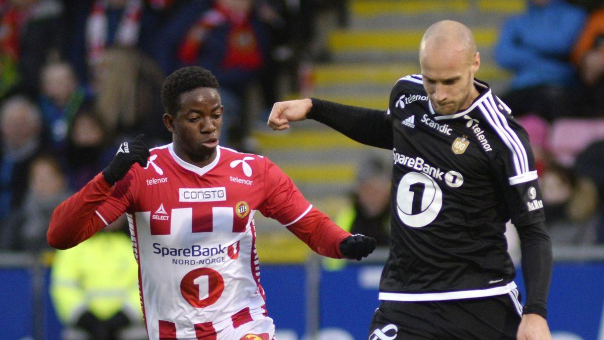 Tromsøs Mushaga Bakenga i duell med Rosenborgs Tore Reginiussen i kampen TIL-Rosenborg på Alfheim stadion