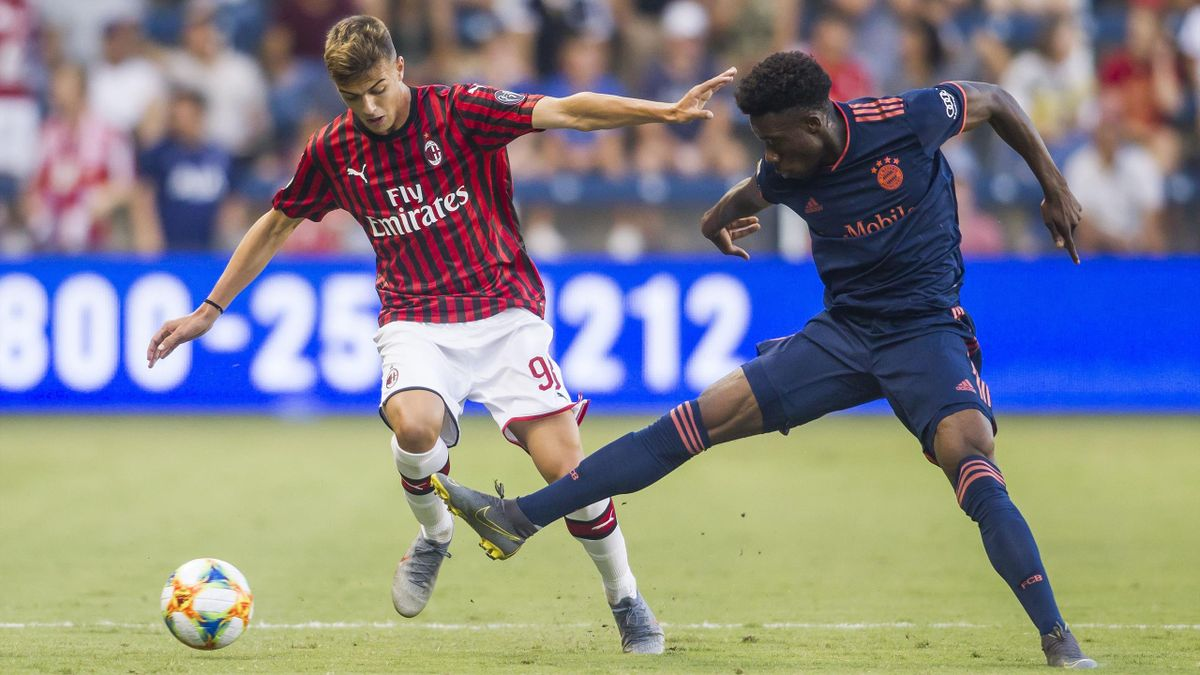 Bayern Munich forward Alphonso Davies (19) disrupts the run of Milan forward Daniel Maldini (98) during the match between FC Bayern and AC Milan on Tuesday July 22, 2019 at Children's Mercy Park in Kansas City, KS.