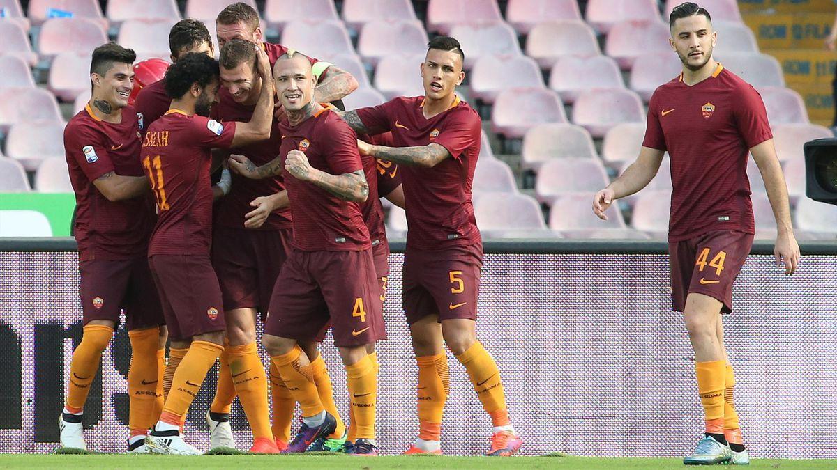 Roma's Edin Dzeko celebrates with his team mates after scoring.