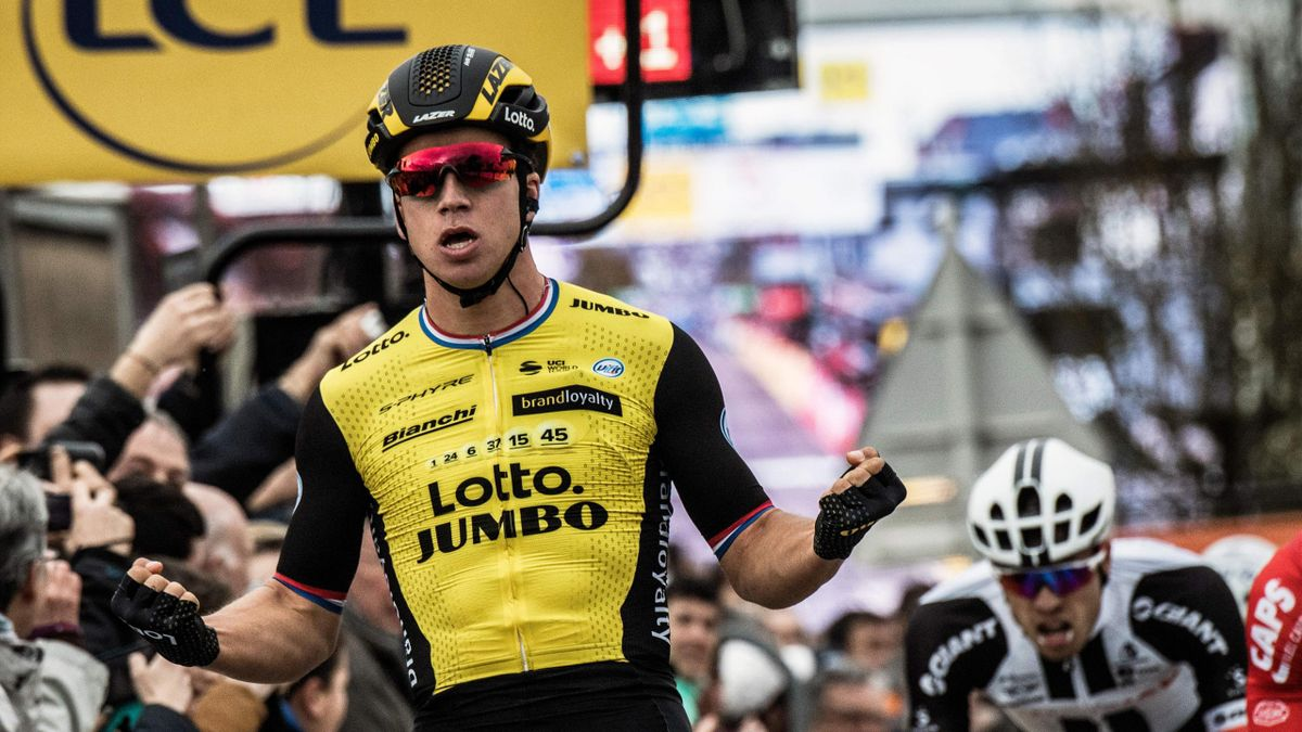 Dylan Groenewegen (L) celebrates as he crosses the finish line to win the second stage of the Paris Nice cycling race between Orsonville and Vierzon, on March 5, 2018