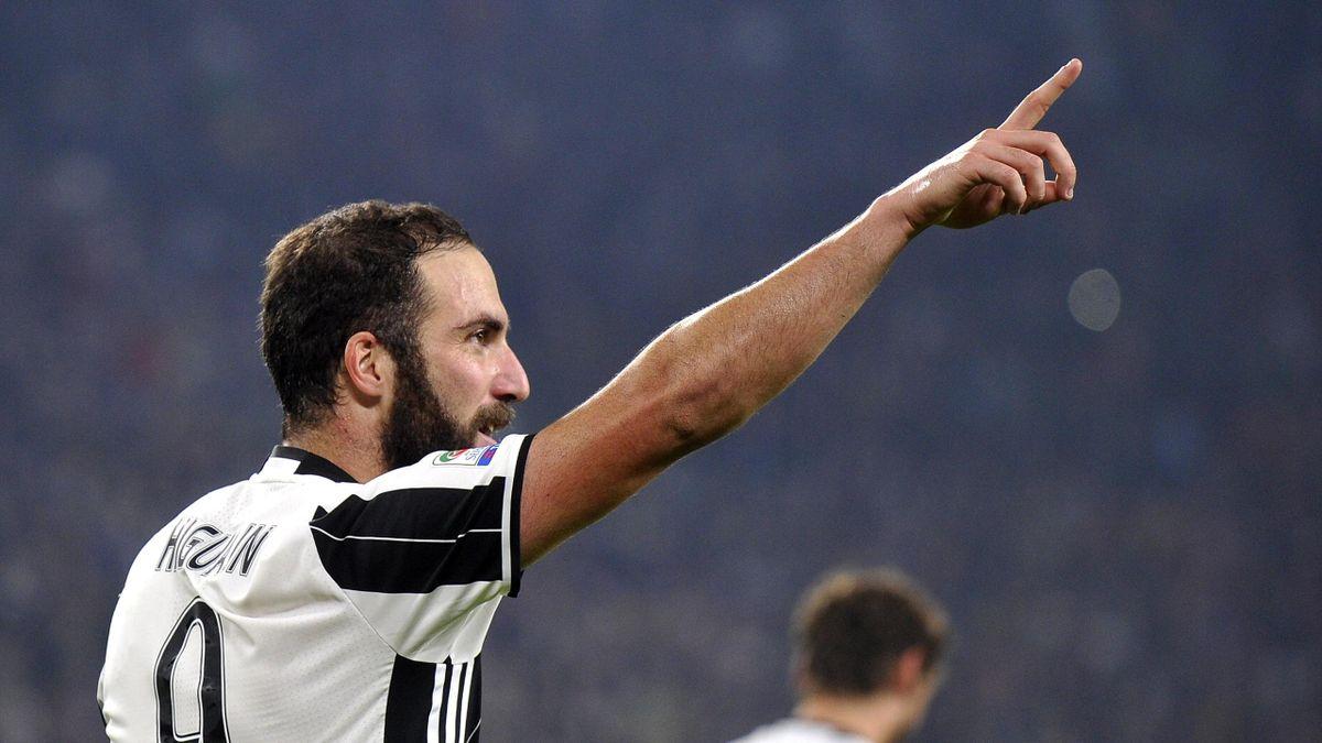 Juventus' Gonzalo Higuain celebrates after scoring second goal