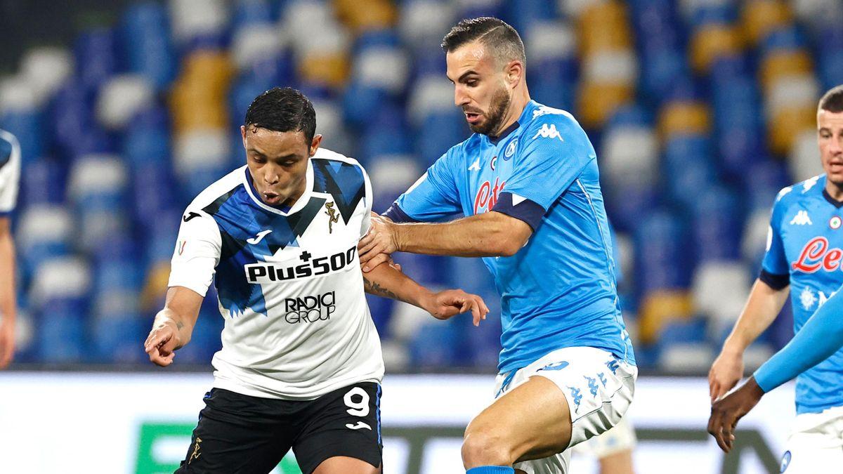 Atalanta's Luis Muriel (L) tussles with Napoli's Nikola Maksimovic