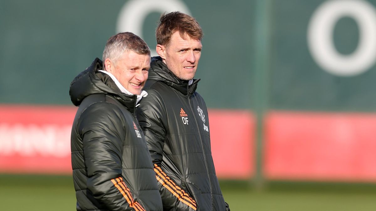 Manchester United Head Coach / Manager Ole Gunnar Solskjaer looks on with Darren Fletcher during a first team training session at Aon Training Complex on January 22, 2021 in Manchester, England.