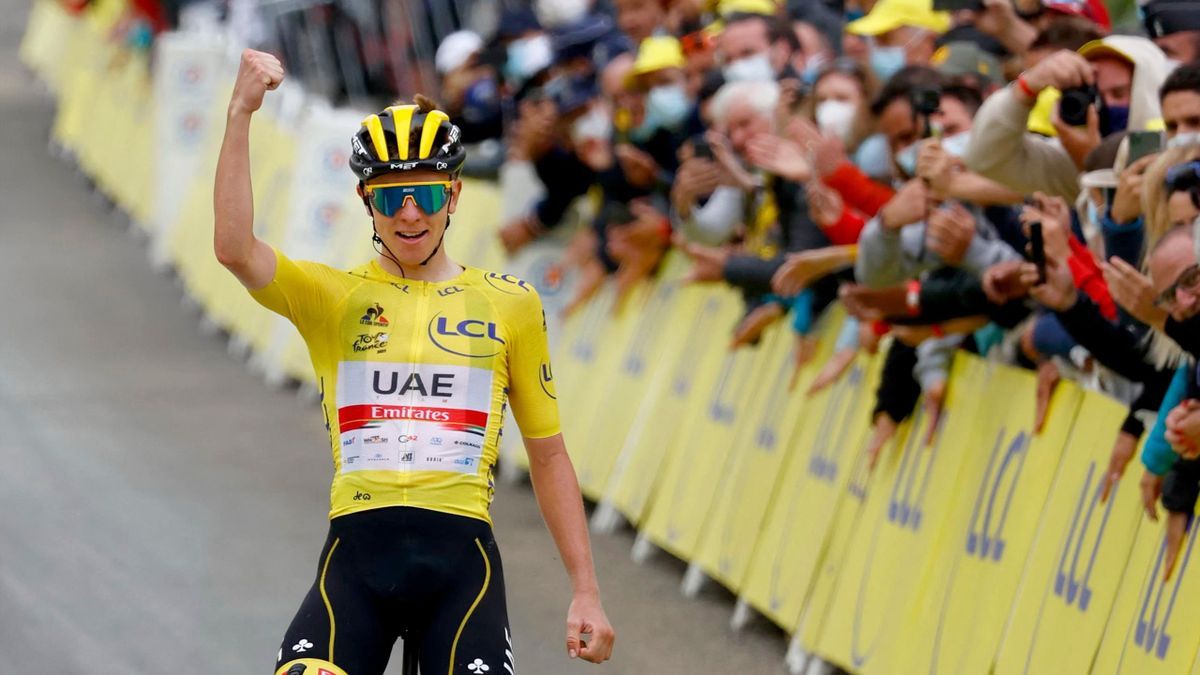 Team UAE Emirates' Tadej Pogacar of Slovenia wearing the overall leader's yellow jersey celebrates as he crosses the finish line during the 18th stage of the 108th edition of the Tour de France cycling race, 129 km between Pau and Luz Ardiden, on July 15,