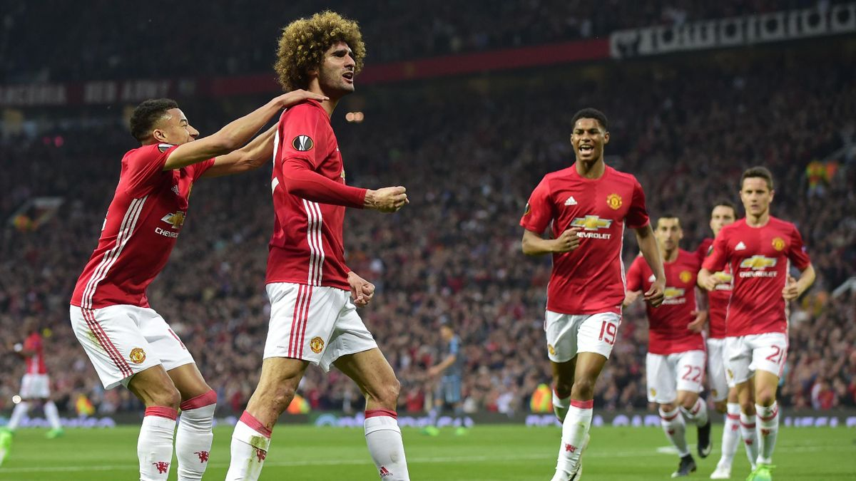 Belgian midfielder Marouane Fellaini (2nd L) celebrates with teammates after scoring the opening goal of the UEFA Europa League semi-final, second-leg football match between Manchester United and Celta Vigo at Old Trafford stadium in Manchester, north-wes