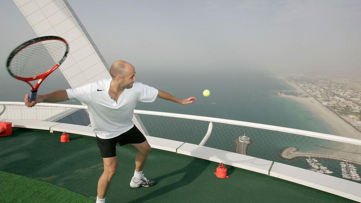 Andre Agassi hits a ball off the Burj Al Arab in Dubai