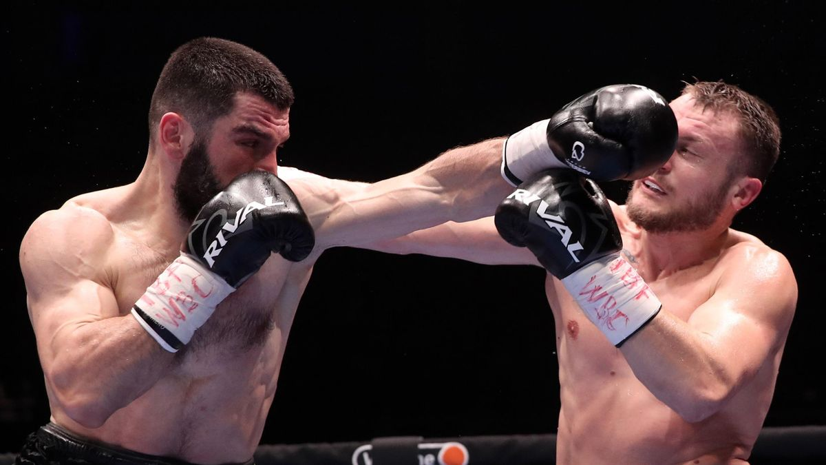 Russia's Artur Beterbiev (L) and Germany's Adam Deines fight in their light heavyweight (79.3) bout at a professional boxing event at Megasport Arena