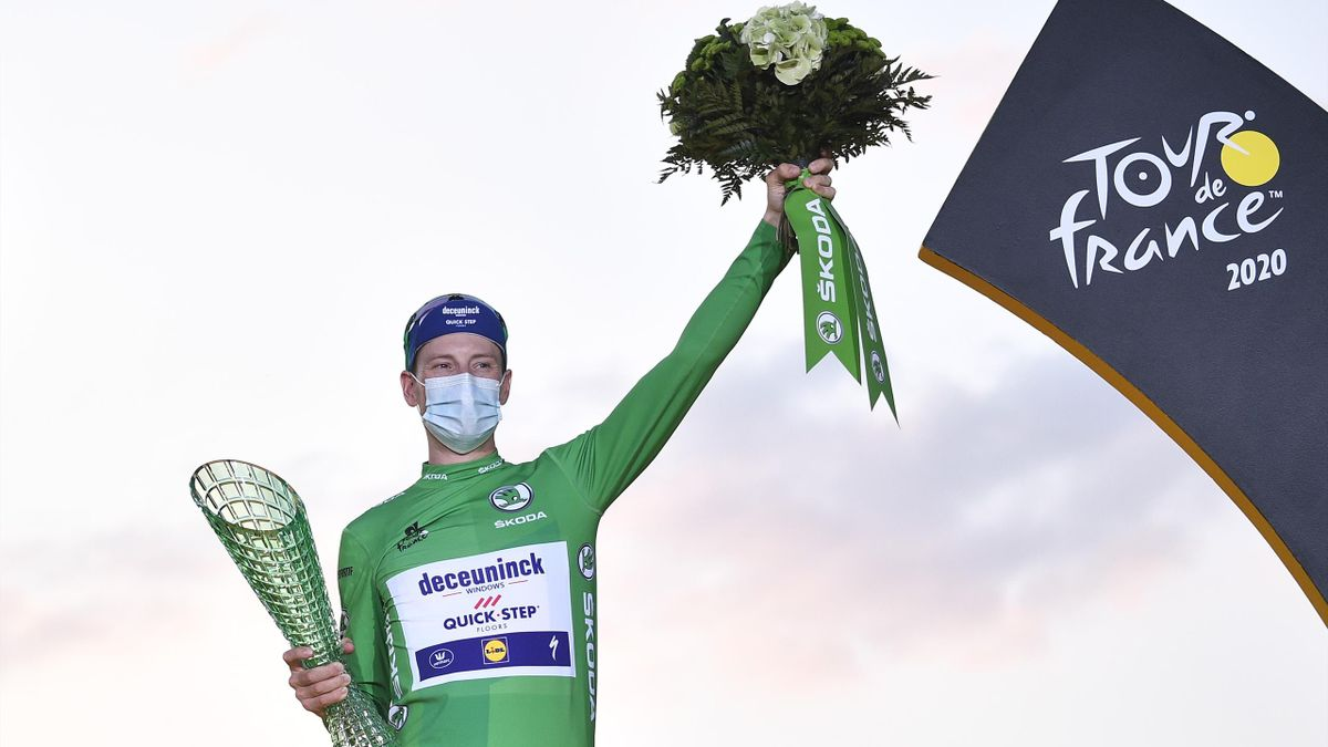 Team Deceuninck rider Ireland's Sam Bennett celebrates on the podium after winning the best sprinter's green jersey of the 107th edition of the Tour de France